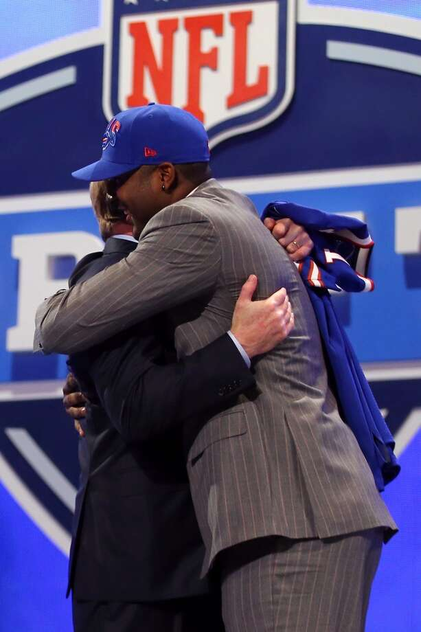 E.J. Manuel of the Florida State Seminoles greets NFL Commissioner Roger Goodell.