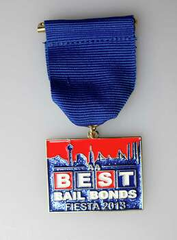 Fiesta Medal Best Bail Bonds 2013 Photo: Juanito M Garza, San Antonio Express-News / San Antonio Express-News