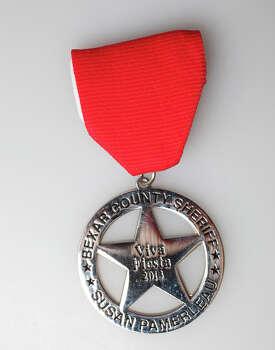 Fiesta Medal Susan Pamerleau 2013 Photo: Juanito M Garza, San Antonio Express-News / San Antonio Express-News