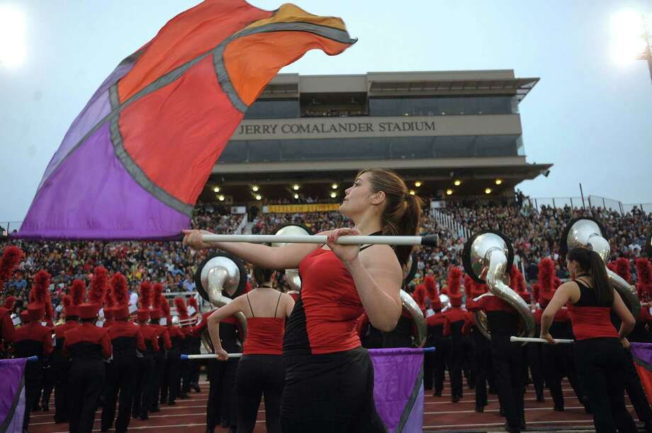 "Kirstin Doll of Taft High School joins her bandmates in a performance during the 75th anniversary Battle of Flowers Band Festival, entitled ""Celebrations!"" at Comalander Stadiium on Thursday, April 25, 2013. Photo: Billy Calzada / San Antonio Express-News"