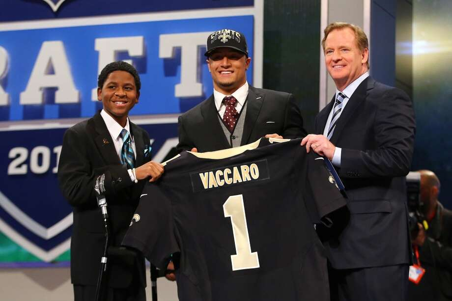 NEW YORK, NY - APRIL 25:  Kenny Vaccaro of the Texas Longhorns, stands with 13-year-old Markell Gregoire (L) and NFL Commissioner Roger Goodell (R) as they hold up a jersey on stage after he was picked #15 overall by the New Orleans Saints in the first round of the 2013 NFL Draft at Radio City Music Hall on April 25, 2013 in New York City.  (Photo by Al Bello/Getty Images)