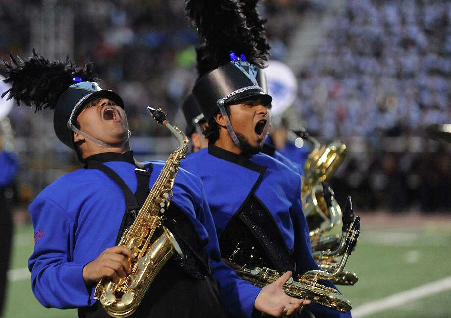 "Memorial High School saxophone players shout during the 75th anniversary Battle of Flowers Band Festival, entitled ""Celebrations!"" at Comalander Stadiium on Thursday, April 25, 2013. Photo: Billy Calzada / San Antonio Express-News"