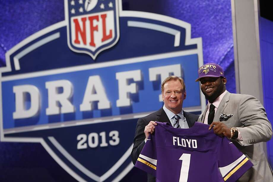 Sharrif Floyd, from Florida, stands with NFL Commissioner Roger Goodell after being selected 23rd overall by the Minnesota Vikings in the first round of the NFL football draft, Thursday, April 25, 2013, at Radio City Music Hall in New York. (AP Photo/Jason DeCrow) Photo: Jason DeCrow, Associated Press