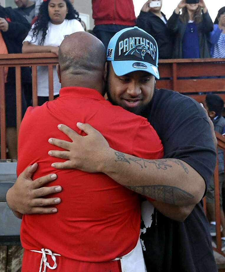 Star Lotulelei, from Utah, receives a hug from his uncle Ti Akau after being selected 14th overall by the Carolina Panthers during an NFL football draft party at their home, Thursday, April 25, 2013, in South Jordan, Utah. (AP Photo/Rick Bowmer) Photo: Rick Bowmer, Associated Press
