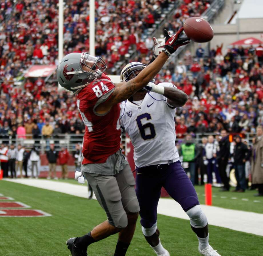 Desmond Trufant, right, defends a pass meant for Washington State receiver Gabe Marks during the Apple Cup on Nov. 23 at Martin Stadium in Pullman. The Cougars beat the Huskies 31-28 in overtime.