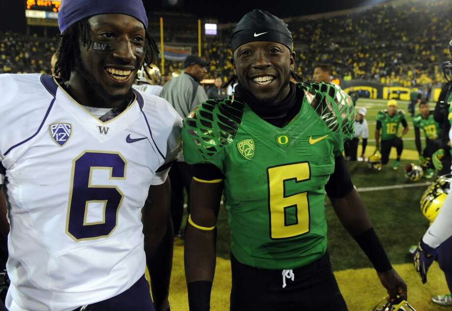 Desmond Trufant, left, talks with Oregon running back De'Anthony Thomas after the Huskies lost 52-21 to the Ducks on Oct. 6 at Autzen Stadium in Eugene, Ore.