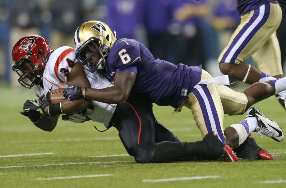Desmond Trufant (6) tackles San Diego State running back Walter Kazee on Sept. 1 at CenturyLink Field in Seattle.