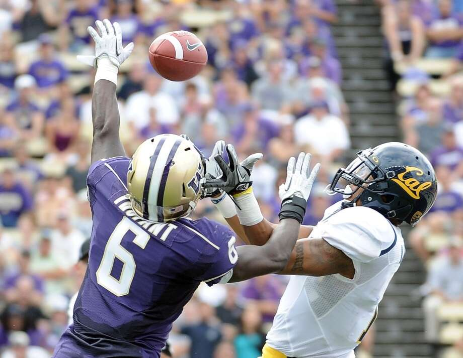 Desmond Trufant, left, defends a pass meant for Cal receiver Marvin Jones on Dept. 24, 2011, at Husky Stadium in Seattle.