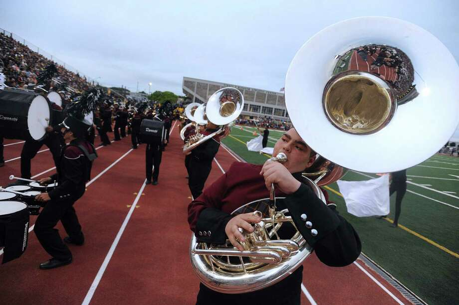 "Devyn Williamson of Highlands High School plays his sousaphone during the 75th anniversary Battle of Flowers Band Festival, entitled ""Celebrations!"" at Comalander Stadiium on Thursday, April 25, 2013. Photo: Billy Calzada / San Antonio Express-News"