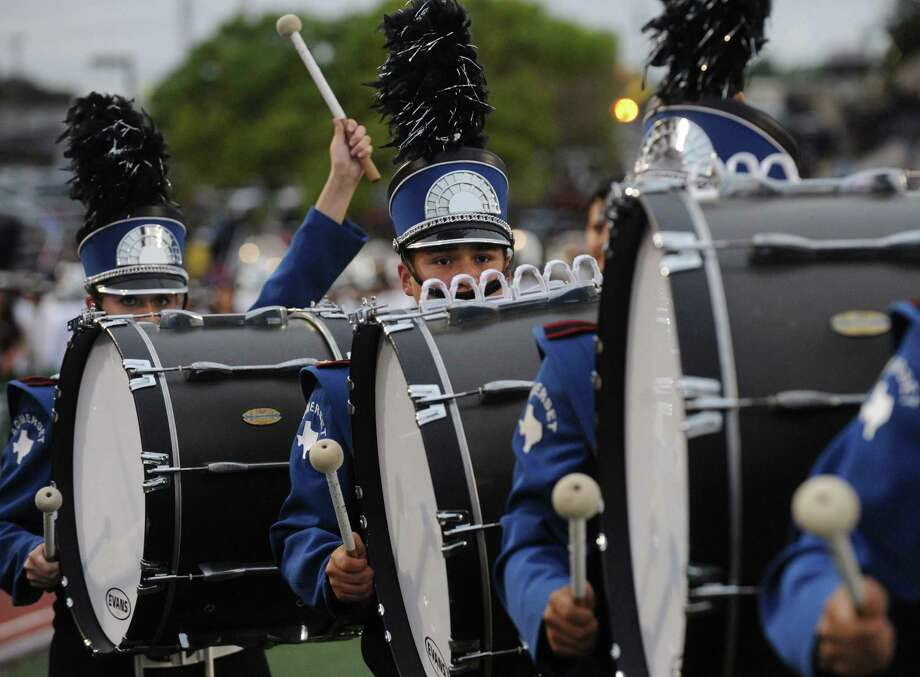 Somerset High School bass drummers play during the Battle of Flowers Band Festival at Comalander Stadiium on Thursday, April 25, 2013. Photo: Billy Calzada / San Antonio Express-News