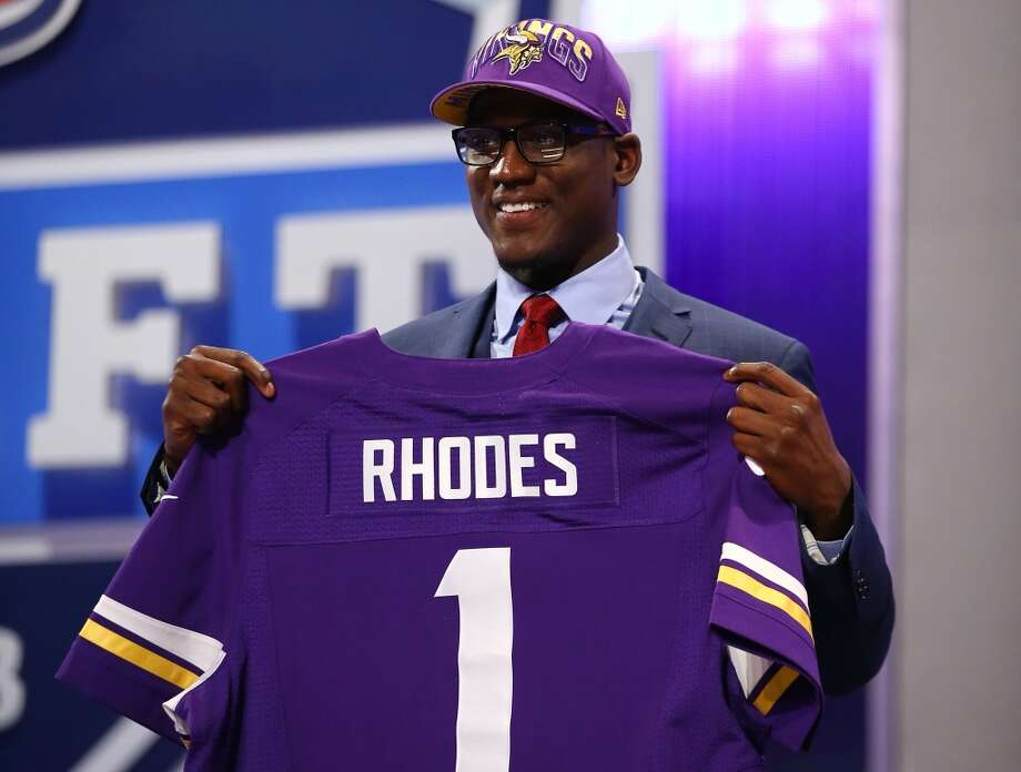 Xavier Rhodes of the Florida State Seminoles holds up a jersey on stage after he was picked #25 overall by the Minnesota Vikings in the first round of the 2013 NFL Draft at Radio City Music Hall on April 25, 2013 in New York City.