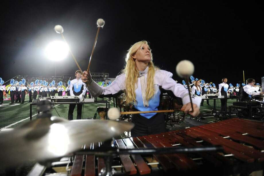 "A percussionist plays along the Johnson Jaguars band during the Battle of Flowers Band Festival, entitled ""Celebrations!"" at Comalander Stadium on Thursday, April 25, 2013. Photo: Billy Calzada / S.A. Express-News / San Antonio Express-News"