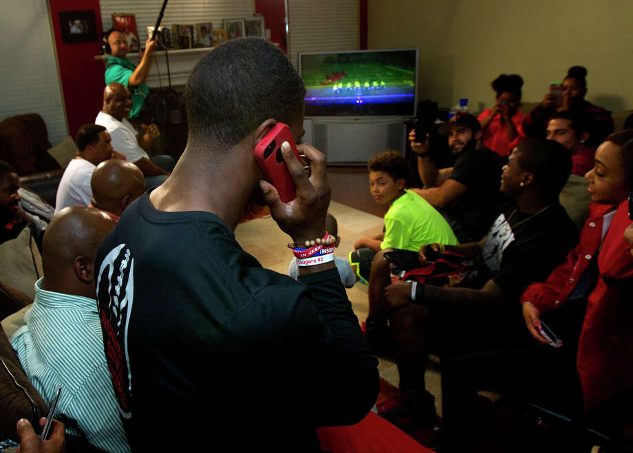 Former University of Houston player D.J. Hayden receives a call from the Oakland Raiders as their pick for the 2013 NFL draft at his house Thursday, April 25, 2013, in Missouri City. Photo: Cody Duty, Houston Chronicle / © 2013 Houston Chronicle
