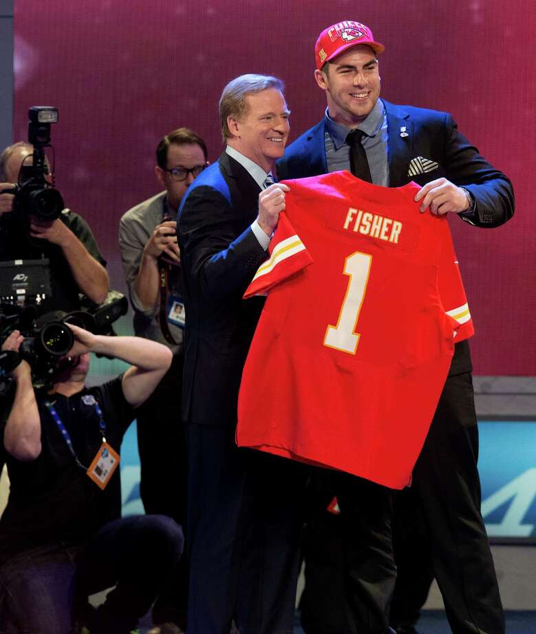 Central Michigan's Eric Fisher stands with NFL Commissioner Roger Goodell after being selected first overall by the Kansas City Chiefs in the first round of the NFL football draft, Thursday, April 25, 2013, at Radio City Music Hall in New York. (AP Photo/Craig Ruttle) Photo: Craig Ruttle, FRE / FR61802 AP