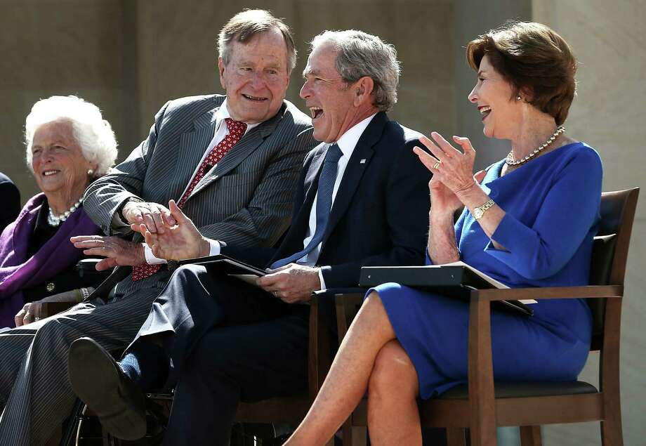Flanked by their wives Barbara Bush (far left) and Laura Bush (far right), former presidents George H.W. Bush and George W. Bush share a laugh at the younger Bush's library dedication on the Southern Methodist University campus. Photo: Alex Wong / Getty Images