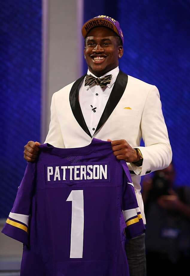 NEW YORK, NY - APRIL 25:  Cordarelle Patterson of the Tennessee Volunteers holds up a jersey after he was selected #29 overall by the Minnesota Vikings in the first round of the 2013 NFL Draft at Radio City Music Hall on April 25, 2013 in New York City.  (Photo by Al Bello/Getty Images) Photo: Al Bello, Getty Images