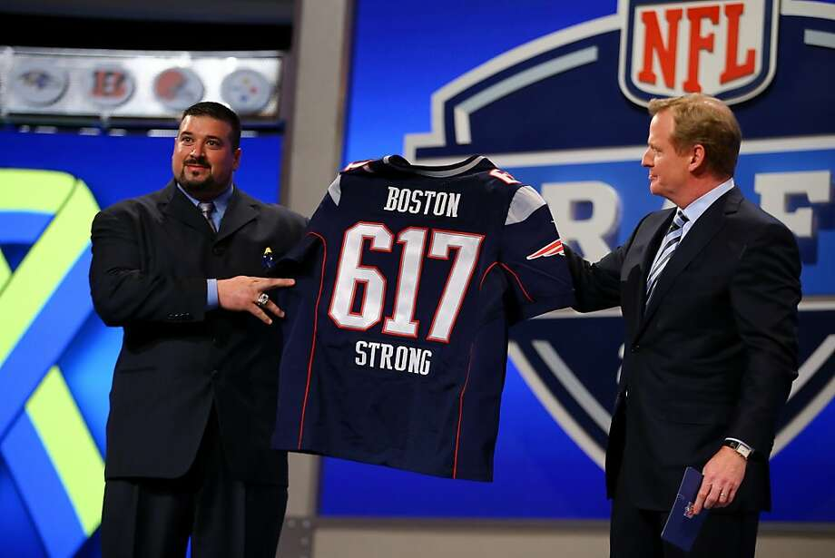 NEW YORK, NY - APRIL 25:  Former New England Patriots player Joe Andruzzi (L) and NFL Commissioner Roger Goodell hold up a New England Patriot jersey with the # 617 on it in honor of the victims and those affected by this years bombing at the Boston Marathon in the first round of the 2013 NFL Draft at Radio City Music Hall on April 25, 2013 in New York City.  (Photo by Al Bello/Getty Images) Photo: Al Bello, Getty Images