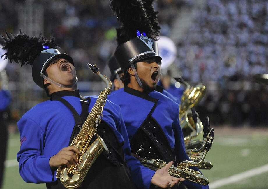Memorial High School saxophone players perform during the 75th anniversary Battle of Flowers Band Festival.  Photo: Billy Calzada, San Antonio Express-News