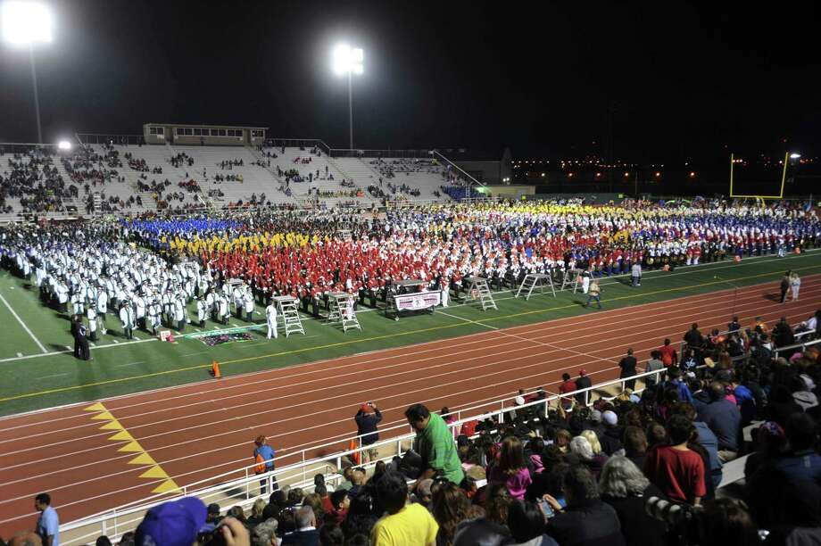 The 27 bands participating in this year's Battle of Flowers Band Festival fill the field at Comalander Stadium on Thursday, April 25, 2013. Photo: Billy Calzada / San Antonio Express-News