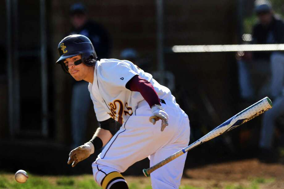 Colonie's Eric Downey bunts the ball during their baseball game against Columbia on Thursday, April 25, 2013, at Colonie High in Colonie, N.Y. (Cindy Schultz / Times Union) Photo: Cindy Schultz / 10022154A