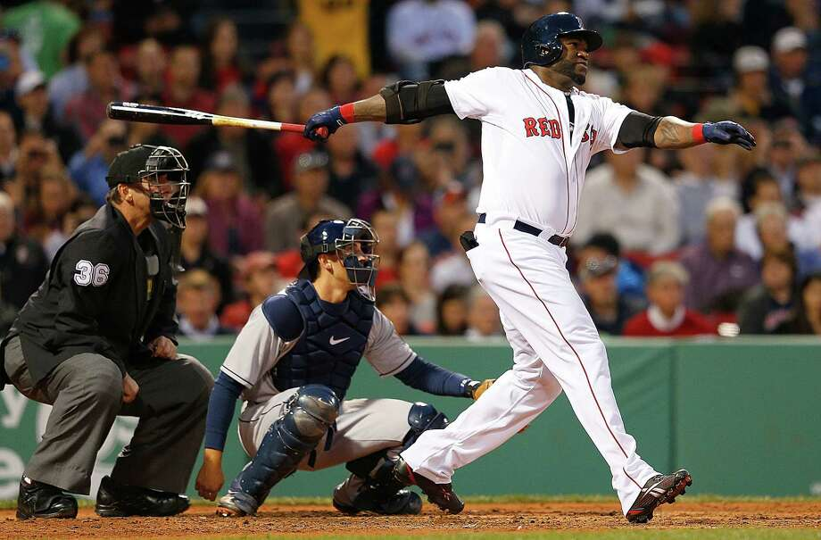 BOSTON, MA - APRIL 25:  David Ortiz #34 of the Boston Red Sox watches the flight of his home run in the 3rd inning against the Houston Astros at Fenway Park on April 25, 2013 in Boston, Massachusetts.  The home run was the first by Ortiz since returning to the team after an injury. (Photo by Jim Rogash/Getty Images) Photo: Jim Rogash