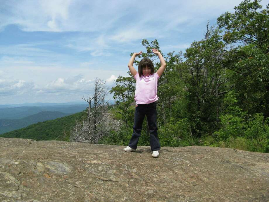 Photo by Gillian Scott. Abby Scott celebrates on the summit of Sleeping Beauty several years ago. Photo: Picasa