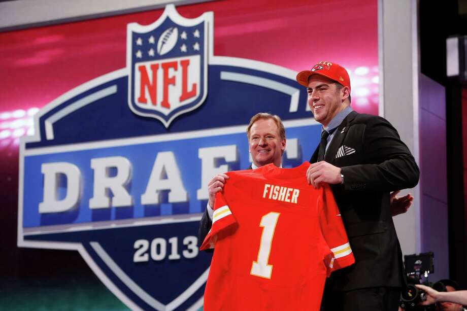 Eric Fisher, from Central Michigan, stands with NFL Commissioner Roger Goodell after being selected first overall by the Kansas City Chiefs in the first round of the NFL football draft, Thursday, April 25, 2013, at Radio City Music Hall in New York. (AP Photo/Jason DeCrow) Photo: Jason DeCrow