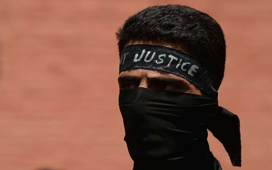 A Kashmiri Public Health Engineering department (PHE) government employee, clad in black, participates in a protest in Srinagar on April 25, 2013. The demonstrating employees demanded the regularization of contractual jobs and hike in wages among other demands.  Photo: Tauseef Mustafa, AFP/Getty Images