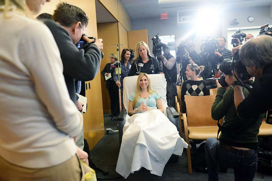 Boston Marathon bombing victim Heather Abbott of Newport, Rhode Island is wheeled into a press conference at Brigham and Women's Hospital April 25, 2013 in Boston, Massachusetts. Abbot had her left leg amputated several inches below the knee after because the injuries sustained after the blast.  Photo: Darren McCollester, Getty Images