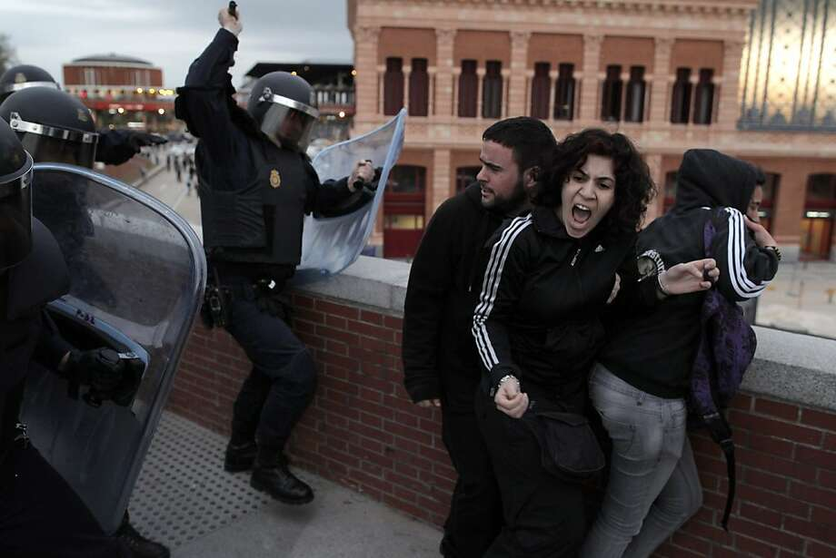 Police clash with demonstrators during a protest near the Spanish Parliament in Madrid, Spain, Thursday April 25, 2013.  The protest, mostly against austerity measures, comes on the day that Spain's jobless figures were released. With over 6 million unemployed for the first time ever, Spain's jobless rate shot up to a record 27.2 percent in the first quarter of 2013, the National Statistics Institute said Thursday, in another grim picture of the recession-wracked country.  Photo: Andres Kudacki, Associated Press