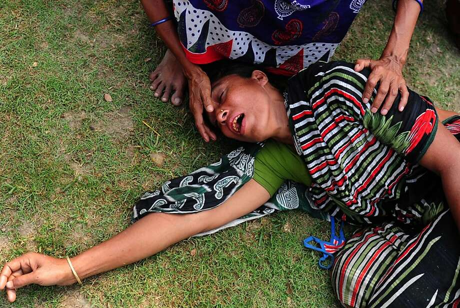 A Bangladeshi woman reacts after identifying the body of her husband killed in the collape of an eight-storey building in Savar, on the outskirts of Dhaka, on April 25, 2013. The death toll in the Bangladesh's worst industrial disaster reached 200 people after rescue workers pulled out scores more corpses from the rubble of a collapsed garment factory building.  Photo: Munir Uz Zaman, AFP/Getty Images