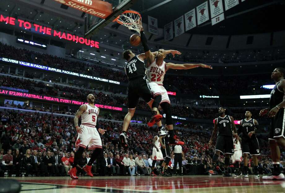 Bulls power forward Taj Gibson (22) dunks on Nets power forward Kris Humphries during the first half of Game 3, part of Chicago's 28-4 run. Photo: Chris Sweda / McClatchy-Tribune News Service