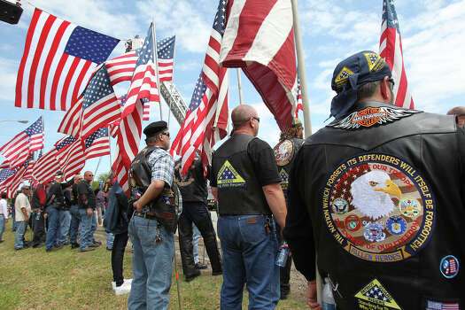 Patriot Guard Riders stand outside as firefighters congregate at Baylor University for memorial services for their fallen comrades in West  on  April 25 2013. Photo: TOM REEL
