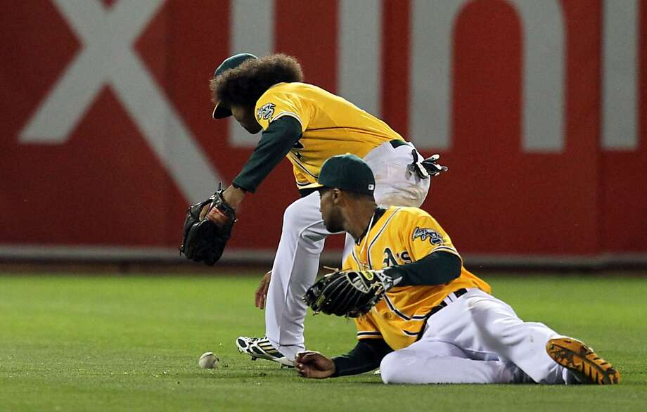 A's center fielder Coco Crisp retrieves J.J. Hardy's single behind left fielder Chris Young in the seventh inning. The hit scored Baltimore's second run of the inning, making the score 8-2. Photo: Lance Iversen, The Chronicle