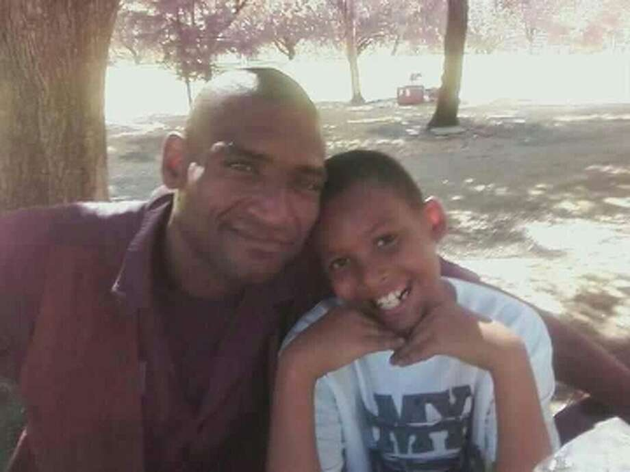 David Thomas, 42, with his son Davon Thomas, 10, of Pittsburg in this undated photograph. David Thomas died March 10, 2013 when he was crushed by a BART elevator in downtown San Francisco. Photo: Valerie Blackmore, Courtesy / ONLINE_YES