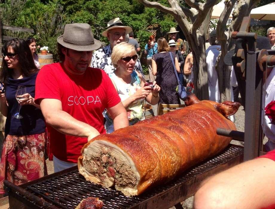 Ari Rosen carving the pig