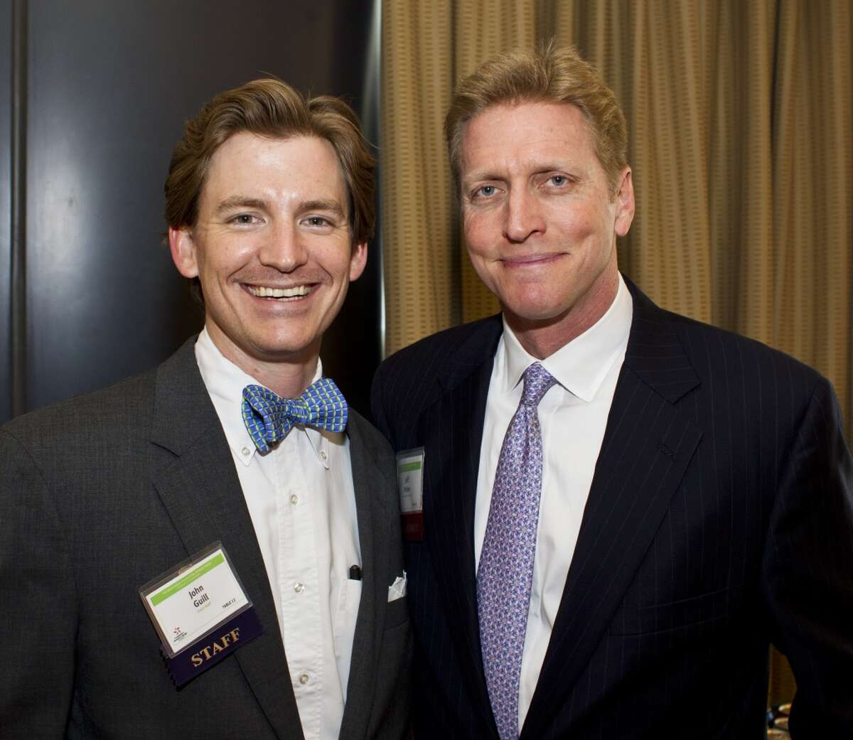 John Guill, left, and Jeff Paine attend a reception before The Council on Alcohol and Drugs Houston's 30th Annual Spring Luncheon, Thursday, April 25, 2013, in Houston. ( Nick de la Torre / Chronicle )