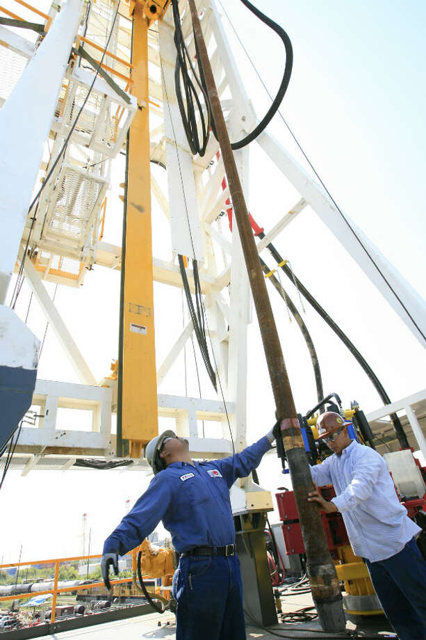 Employees of National Oilwell Varco demonstrate the workings of an oil rig at their Galena Park yard on the Houston Ship Channel, where they outfit rigs for land and sea. Photo: Eric Kayne, Houston Chronicle