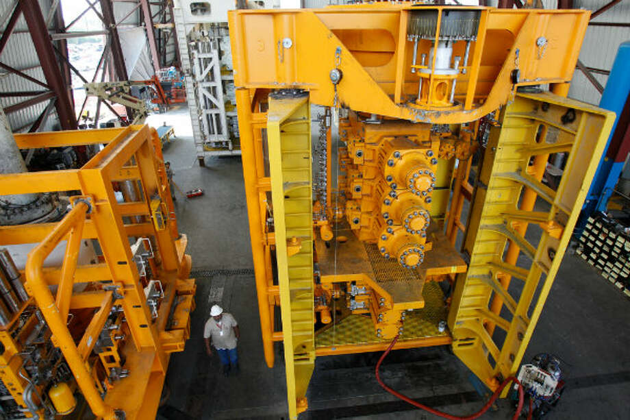 A lower marine riser package, left, and a lower BOP stack shown at a National Oilwell Varco facility in Houston. NOV is one of the largest manufacturers of this kind of equipment. Photo: Melissa Phillip, Houston Chronicle