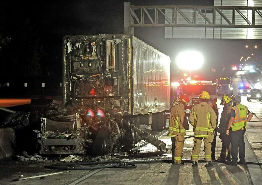 An eighteen-wheeler caught fire in the west bound lane of Interstate 10 near the Martin Luther King Boulevard exit after nine o'clock on Thursday, April 25, 2013.  The cause of the fire is undetermined at the moment. Photo taken: Randy Edwards/The Enterprise