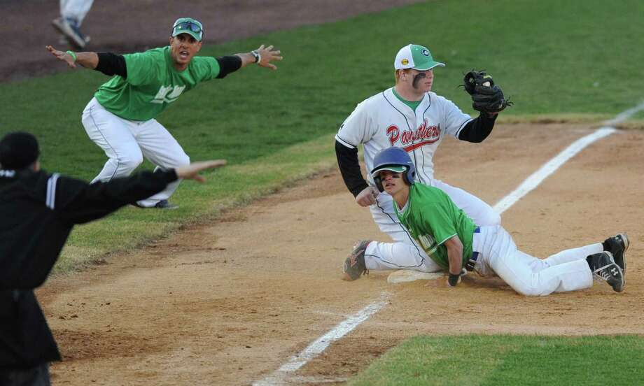 "Newtown's Matt Hoyt slides safely into third base before the tag from Pomperaug's Jack Yule during Newtown's 5-4 win over Pomperaug in the baseball ""Game to Remember"" at The Ballpark at Harbor Yard in Bridgeport, Conn. on Thursday, April 25, 2013.  The game was played to honor and acknowledge Sandy Hook Elementary School and the first responders of the December 14 tragedy.  All proceeds benefitted the Sandy Hook Volunteer Fire Department. Photo: Tyler Sizemore / The News-Times"