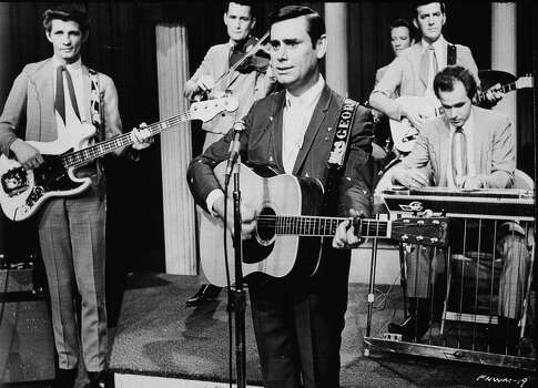 American country singer and songwriter George Jones performs with his band on stage for the film, 'From Nashville With Music,' directed by Eddie Crandall, 1969. Photo: Frank Driggs Collection, Getty Images / 2003 Getty Images