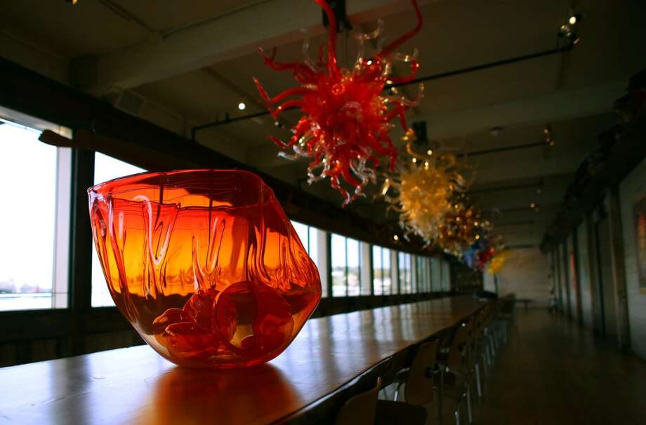 "One of Dale Chihuly's completed ""fire orange baskets"" sits on the table at the artist's Lake Union Boathouse on Thursday, April 25, 2013. The baskets, among the largest he has created, will be part of a temporary installation in the Glasshouse at the Chihuly Garden and Glass. (Joshua Trujillo, seattlepi.com)"