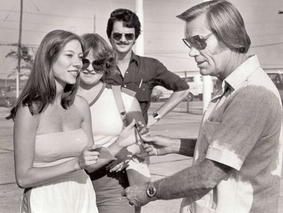 Country singer George Jones signs autographs after arriving at the Jefferson County Airport. The artist had arrived by private jet to appear in a concert at The Palace restaurant in Beaumont. Photo: The Beaumont Enterprise archives.