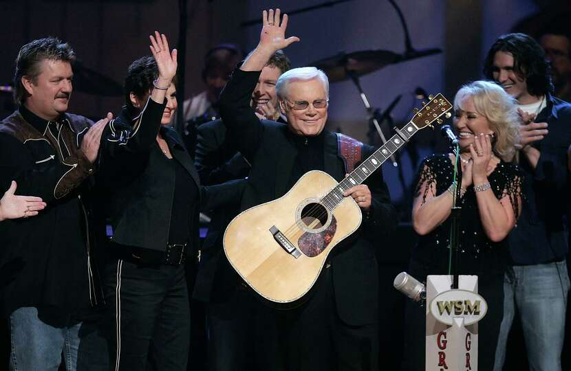 FILE - In this Sept. 12, 2006 file photo, Country music legend George Jones waves to the crowd durin