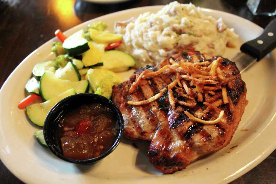 For mySA Just a Taste: At Hofbrau at the Rim: The Hofbrau Chop, a 10-ounce, bone-in pork chop, grilled and served with a jalapeno-apple chutney, ranch mashers and sauteed vegetables.