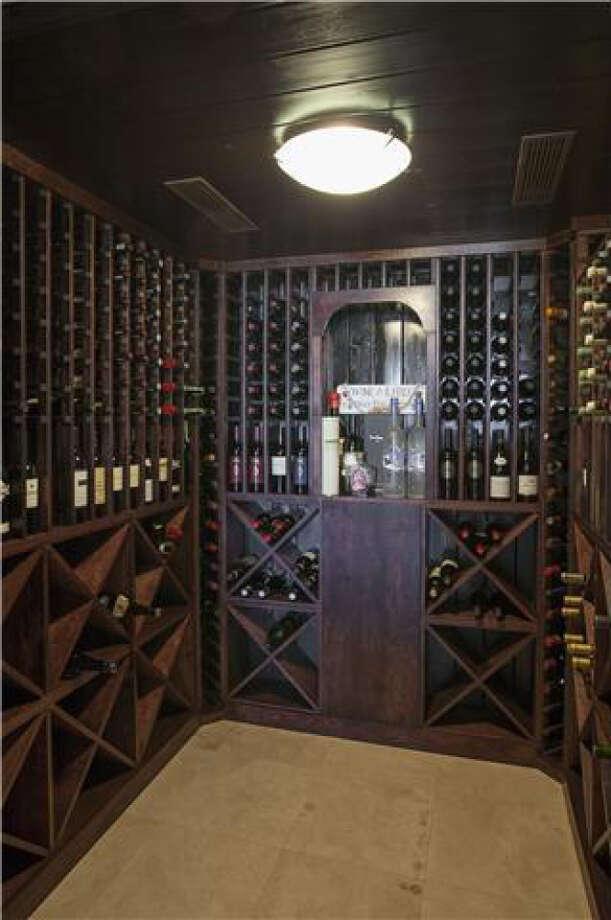 Wine and sake for days. Photos via Realtor.com