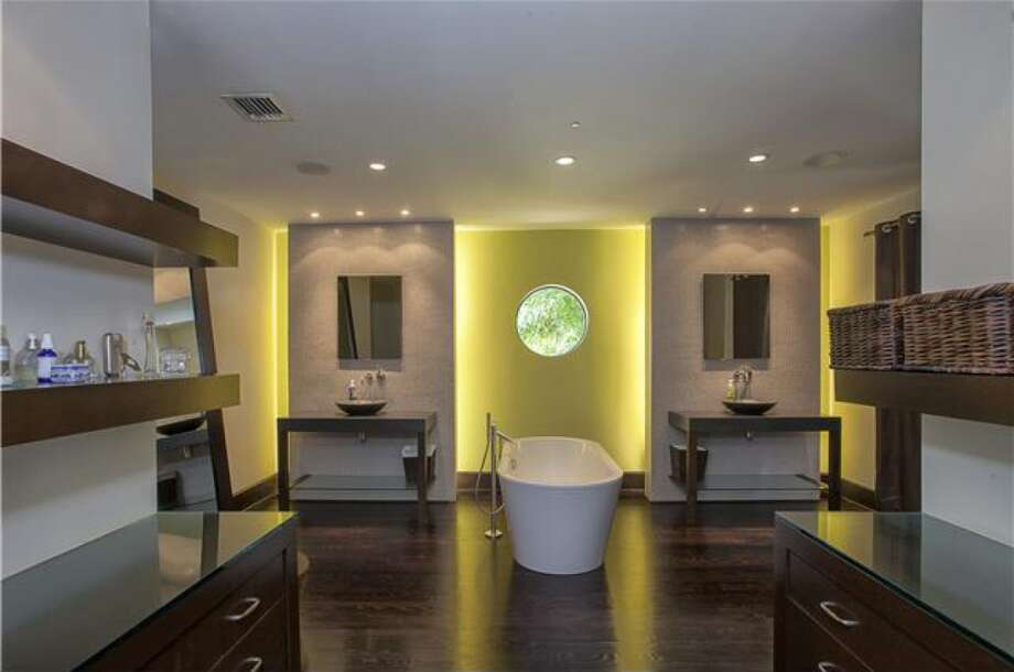 Sexy, strangely Miami Vice bathroom. Photos via Realtor.com