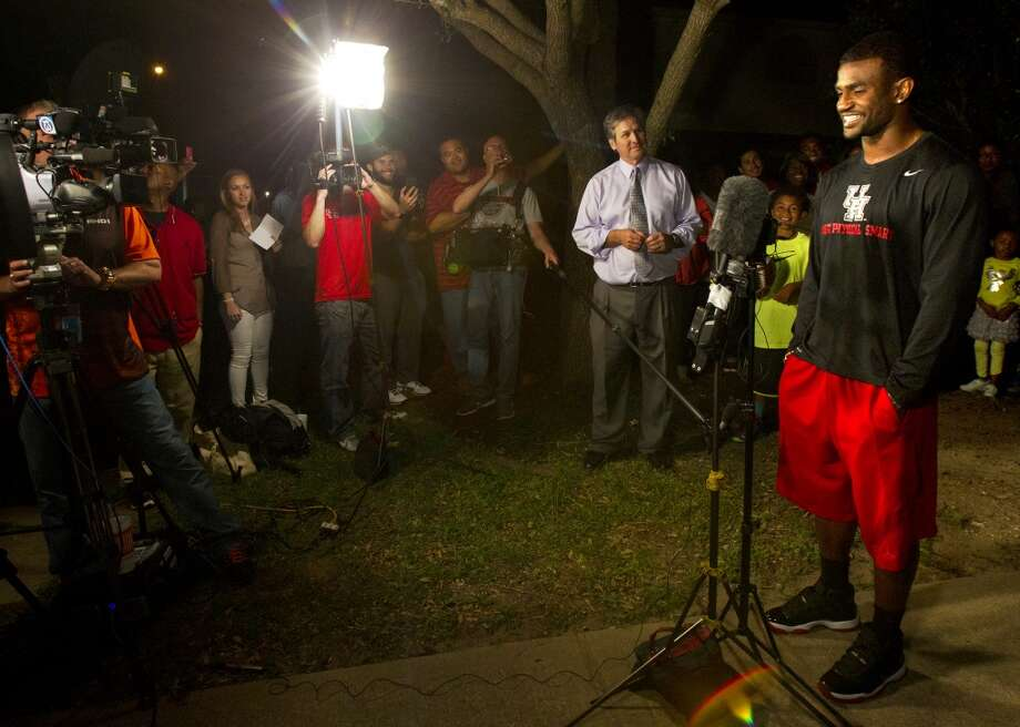 Former University of Houston player D.J. Hayden, right, talks to the media after he was picked by the Oakland Raiders in the 2013 NFL draft at his house Thursday, April 25, 2013, in Missouri City.