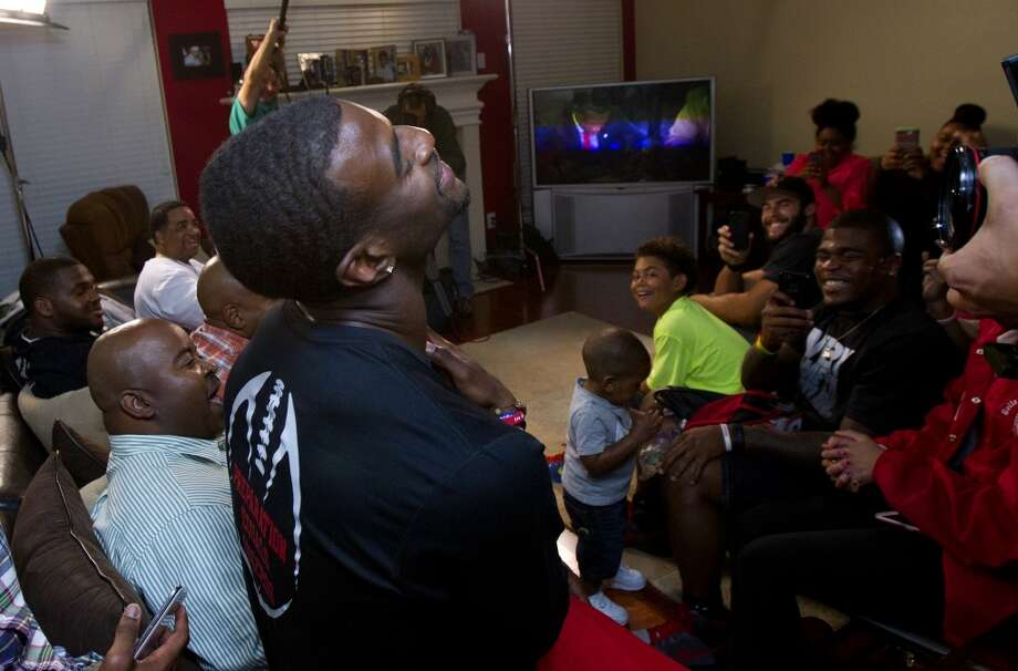 Former University of Houston player D.J. Hayden has a moment of silence as he receives a call from the Oakland Raiders as their pick for the 2013 NFL draft at his house Thursday, April 25, 2013, in Missouri City.